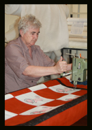 Finishing Touch embroidery, long-arm machine quilting, purses, gifts, school mascots, sport bags